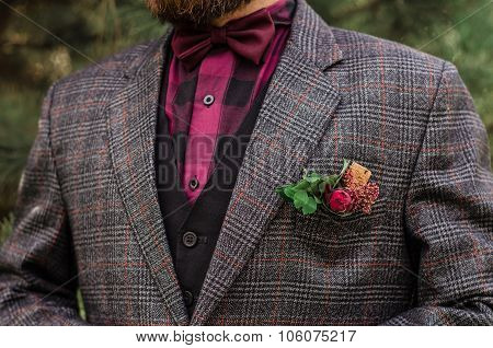 Cool Boutonniere On Hip Trendy Groom At Wedding. Grey Suit, Colorful Vinous Boutonniere. Maroon Bow