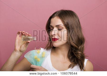 Woman With A Bottle Of Lotion