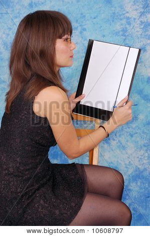 Beautiful business woman with a folder and glasses