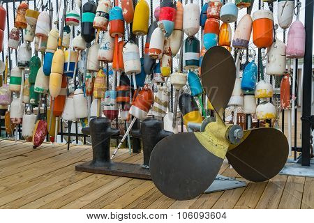 Lobster Buoys Hanging On A Fence
