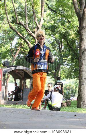 Bangkok - October 23: Unidentified Runner Participates Wearing Fancy Costume In Ekiden 2015 Marathon
