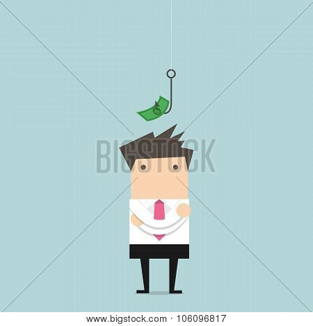 Businessman standing in front of a hook with a dollar sign as bait
