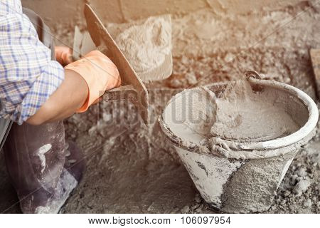 Plasterer Concrete Worker At Wall Of Home Construction Building