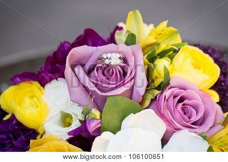 Diamond wedding ring on a bridal bouquet