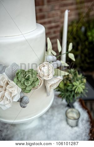 Elegant wedding cake with sugar flowers and succulents