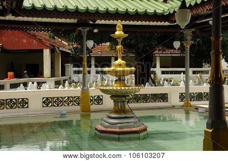 Ablution fountain at the Kampung Kling Mosque at Malacca, Malaysia