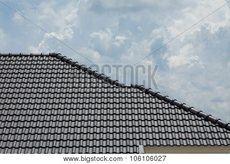 Black Tile Roof On Building Residence House