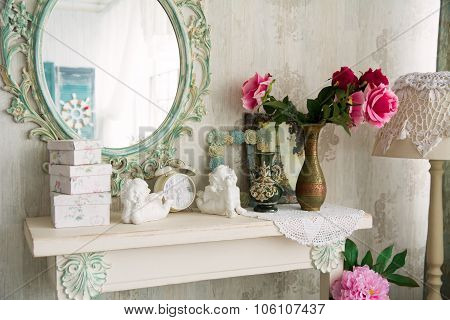 Closeup Vintage Interior With Mirror And A Table With A Vase And Flovers