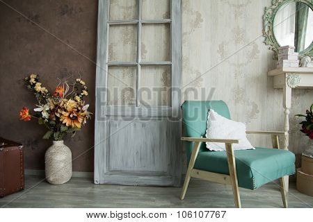 Interior Retro Room With An Armchair, Flowers, Door And Mirror