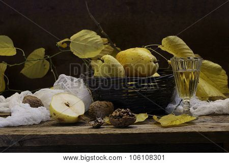 Wine In A Transparent Wine-glass And Pears In A Wattled Basket