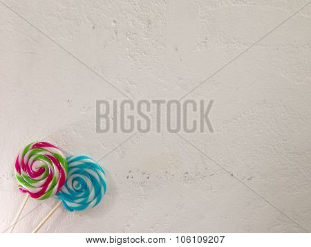 Lollipops on blank White wall