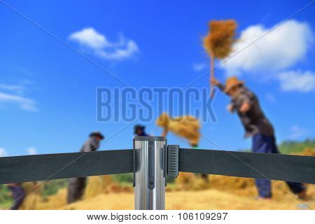 Barricade With Place Is Off Limits To Farmer Threshing Grain In Rice Field (do Not Entry) As Blur Ba