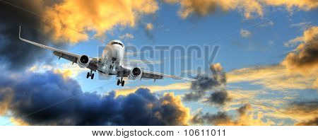 Panorama Of Airplane In Sunset Sky