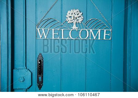 The Inscription On The Blue Door Welcome