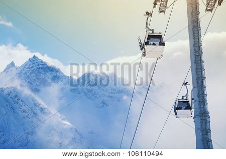 Cable Car On The Ski Resort And Snow-covered Mountains