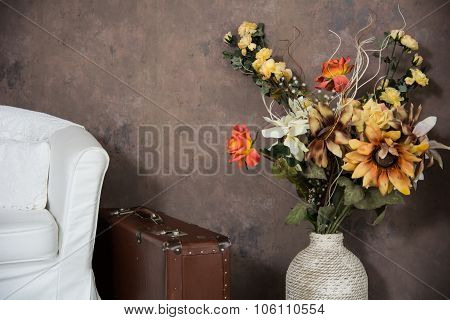 Design Vintage Interior With Flowers In A Vase Suitcases And Chairs.