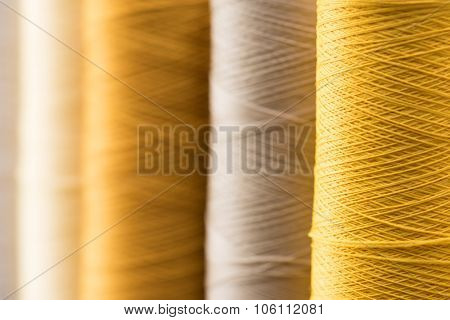 Sewing threads in gold tone. Intentionally shot with extremely Shallow depth of field.