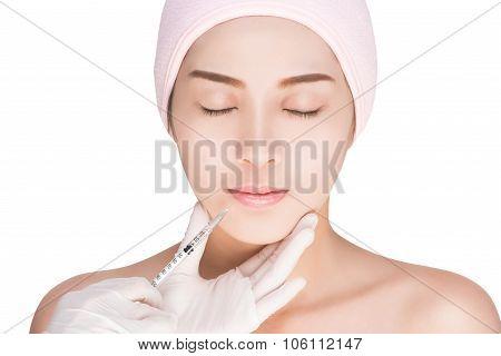 Woman having facial injections