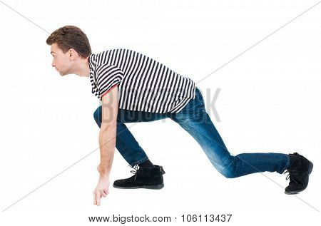 side view man start position.  Rear view people collection.  backside view of person.  Isolated over white background. The guy in the striped shirt is getting ready for a sprint.