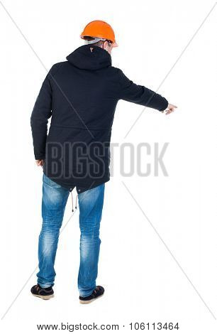 Back view of  pointing young men in parka and helmet. Young guy  gesture. Rear view people collection.  backside view of person.  Isolated over white background.