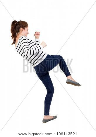 skinny woman funny fights waving his arms and legs. Isolated over white background. Frenchwoman in vest standing fighter's pose.