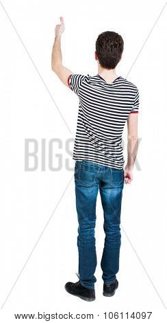 Back view of  man in shirt shows thumbs up.   Rear view people collection.  backside view of person.  Isolated over white background. The guy in the striped T-shirt shows the right hand thumb up.