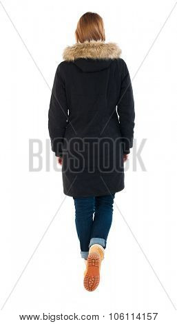 Back view of going  woman in parka. walking young girl. Rear view people collection.  backside view of person.  Isolated over white background. Woman in yellow shoes moves forward