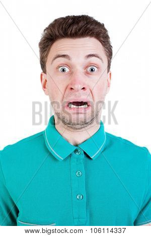 Scared or disgusted man in a blue sweater. Isolated on white background