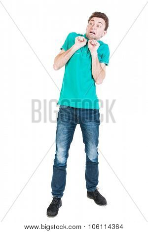 frightened man stood with a frightened look on his face. Isolated on white background
