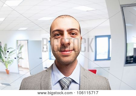Fish-eye portrait of a businessman in his office