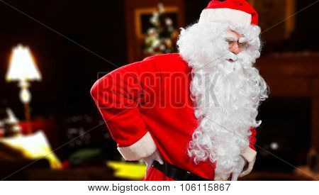 Santa Claus is tired and has a terrible backache