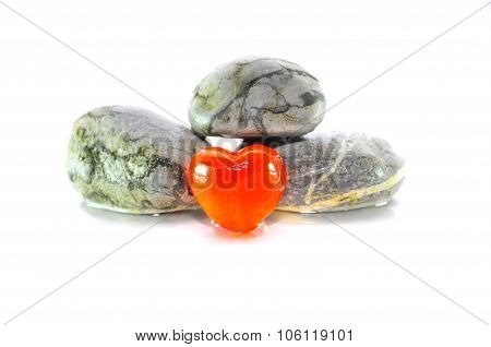 Zen And Spa Stone With Heart Marble Over White Background