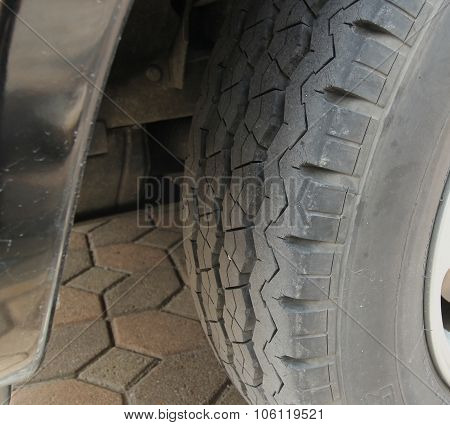 Brand New Car Tire Closeup Photo. Modern Car Tire