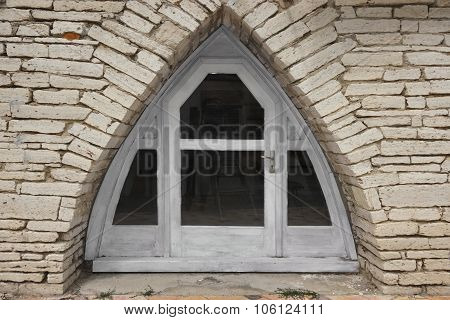 Triangle Arch In The Stone Wall With Door And Windows
