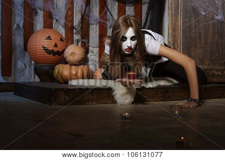 Witch Crawling On The Floor Among The Candles