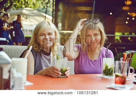 Two Women  In Outdoor Cafe