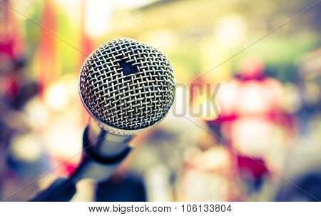 Old microphone in front of colorful background