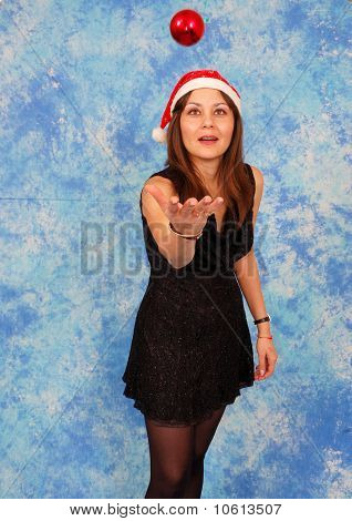 Happy Woman With Christmas Ornament