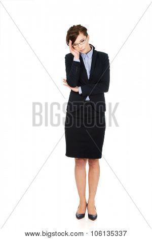 Thoughtful worried businesswoman touching her head.