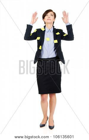 Businesswoman with adhesive cards and hands up.