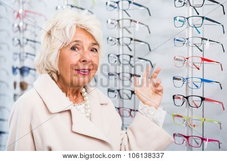 Senior Woman In Optician Store