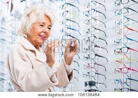 Choosing Glasses In Optician Store