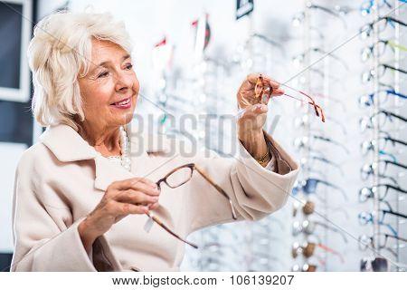 Female Customer In Optician Store