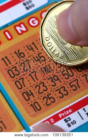 Coquitlam BC Canada - October 24, 2015 : Woman scratching lottery tickets. The British Columbia Lottery Corporation has provided government sanctioned lottery games in British Columbia since 1985.