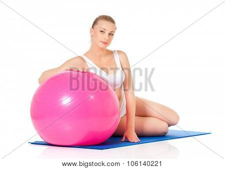 Portrait of fitness woman with fitness-ball on white background