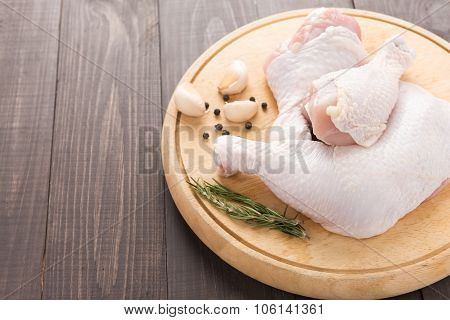 Raw Chicken Leg And Pepper, Garlic, Rosemary On Wooden Background