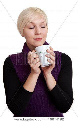 Woman Relaxing With Coffee And Closed Eyes
