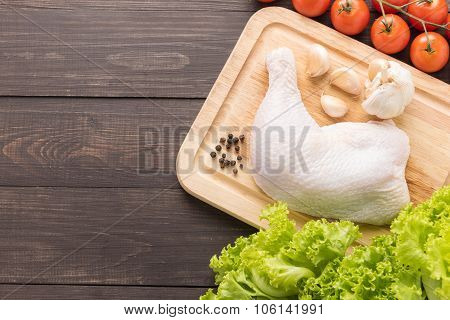 Ingredients And Raw Chicken Leg On Cutting Board On Wooden Background