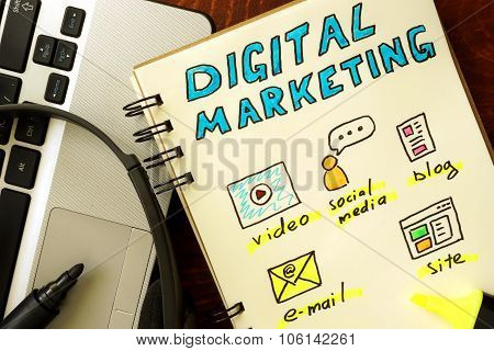 Notepad with digital marketing concept.