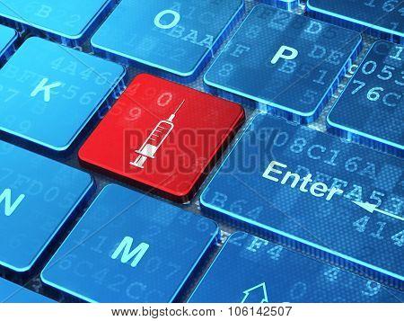 Medicine concept: Syringe on computer keyboard background